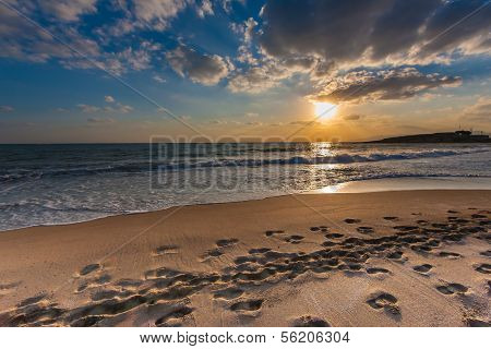 Cloudy Sunset Over A Deserted Beach