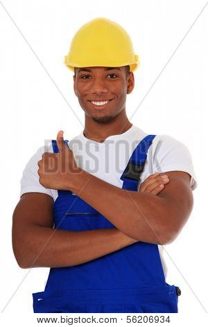 Attractive black manual worker showing thumbs up. All on white background.