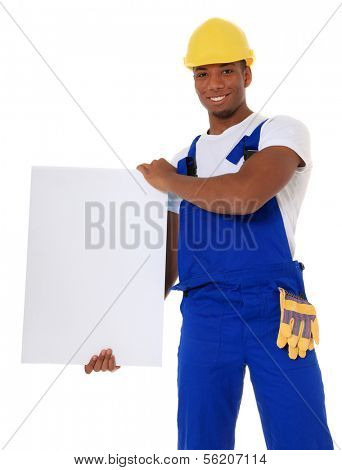 Attractive black manual worker holding blank white sign. All on white background.