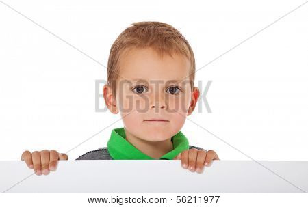 Attractive young boy behind blank white sign. All on white background.