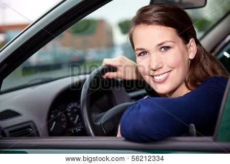 Attractive young woman in car