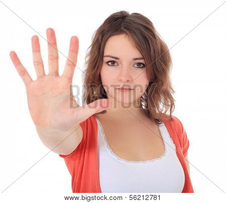 Attractive teenage girl with repelling gesture. All on white background.