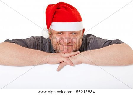 Charismatic middle aged man wearing christmas hat. All on white background.