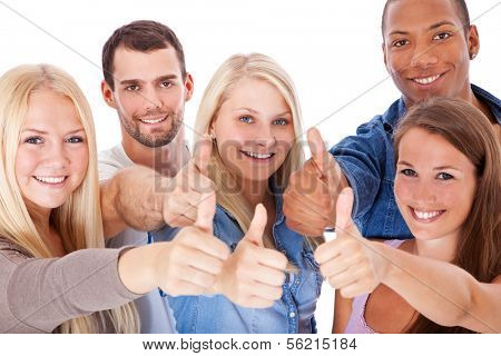 Group of young people showing thumbs up. All on white background.