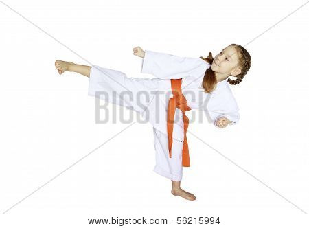 In kimono little girl athlete beat kicking blow