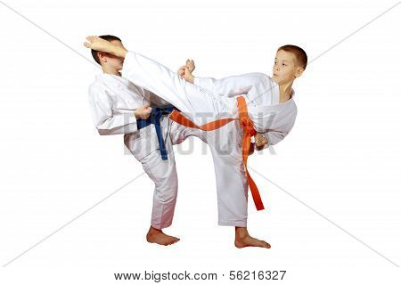 On a white background boys athletes train karate exercises