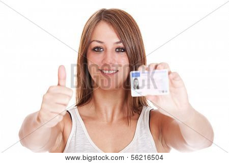 Attractive young woman proudly showing her drivers licence. Details on drivers licence have been changed and blurred out. All on white background.