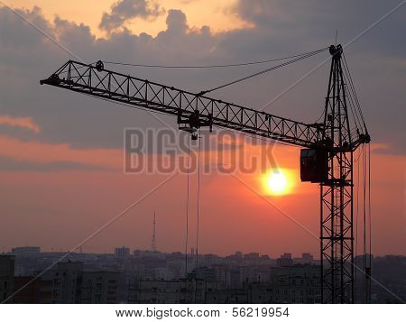 lifting crane with evening sunset background