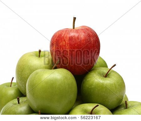 domination concepts - red apple on pyramid of green apples