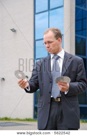 Businessman Holding Three Cd/dvds