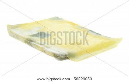 Slices of mouldy cheese