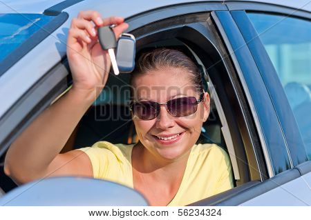 Girl Shows Off The Key To The New Car