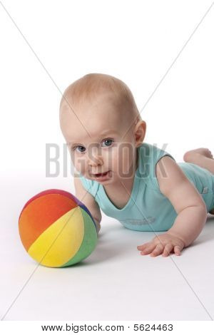 Baby boy with a colored soft ball