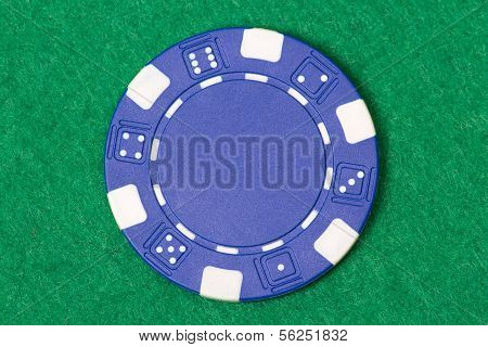 Blue Poker Chip On The Casino Table