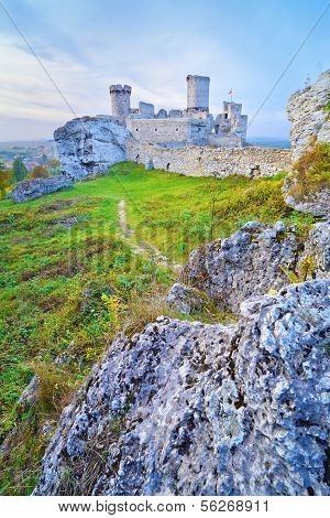 The Ruins Of Old Medieval Castle On Rocks.