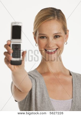 Young Woman Holding Up Phone Towards Camera