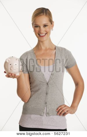 Young Woman Holding Up Piggy Bank