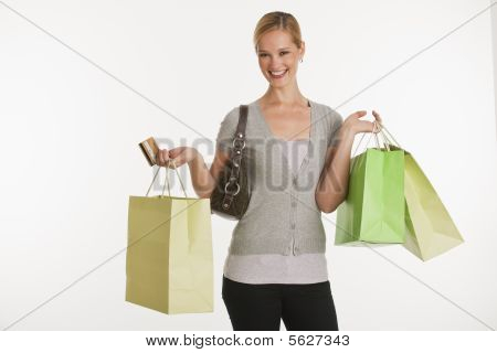 Young Woman With Shopping Bags And Credit Card