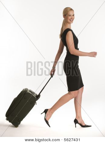 Businesswoman Traveling With Rolling Suitcase