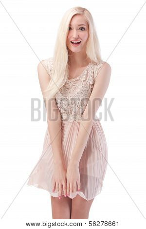 Attractive Blonde Woman Posing With Wind In The Hair And Dress