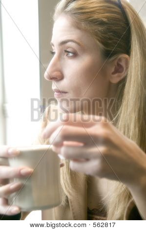 Blonde Woman Drinking Tea