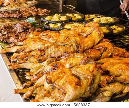 Many grilled chicken on the grill for sale.