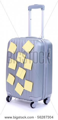 Suitcase with paper stickers isolated on white