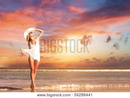 Gorgeous woman on the beach at sunset