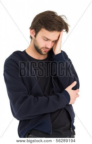 Cool young man with headache over white background