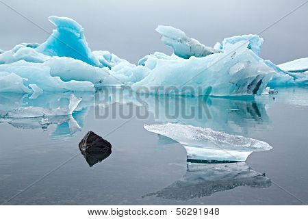 Melting glacier ice Jokulsarlon lake borders National Park. Iceberg landscape Iceland at Joulsarlon glacier lagoon drifting pack ice melting by global warming beautiful arctic travel cold wilderness