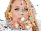 image of scandinavian descent  - Attractive teenage girl having fun with confetti - JPG