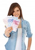 picture of scandinavian descent  - Attractive teenage girl holding 150 euro - JPG