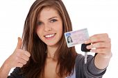 pic of scandinavian descent  - Attractive teenage girl proudly showing her driver - JPG