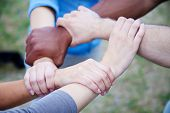stock photo of loyalty  - Various people holding hands symbolizing loyalty - JPG
