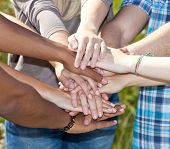 stock photo of loyalty  - Various young persons showing symbol of loyalty - JPG