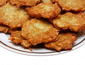 picture of frizzle  - heap of potato pancakes on plate - JPG