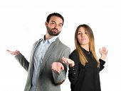 Couple Making Unimportant Gesture Over  White Background