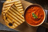 stock photo of tomato sandwich  - Grilled Cheese Sandwich with Creamy Tomato Basil Soup - JPG