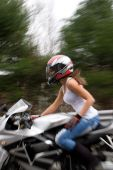 picture of crotch-rocket  - Abstract blur of a pretty girl driving a motorcycle at highway speeds - JPG