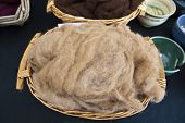 foto of alpaca  - Fleece of fine alpaca wool in natural colour.