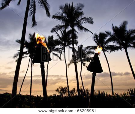 Torches light the evening on the beach in Wailea on Maui
