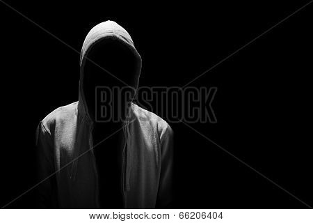 Portrait Of Invisible Man In The Hood Isolated On Black