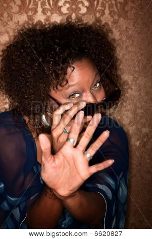 African American Woman Fending Off A Camera
