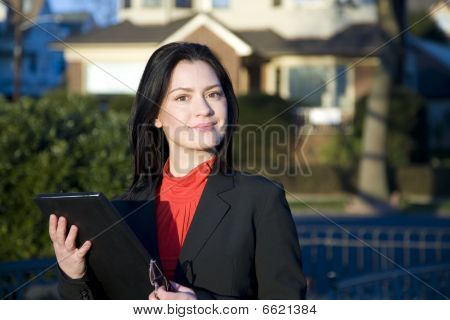 Confident Real Estate Woman in Red