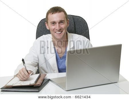 Friendly Young Male Doctor Sitting In The Office