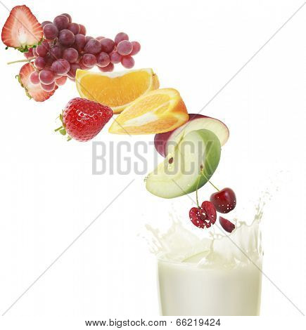 various type of fruit slices stacked with a splash