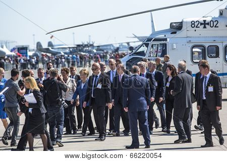 BERLIN, GERMANY - MAY 20 , 2014 : Arrival in a helicopter of German Chancellor Angela Merkel on open up the International aviation and space exhibition ILA.