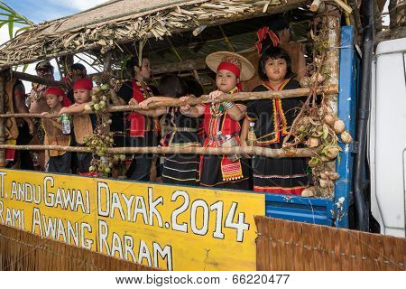 SARAWAK, MALAYSIA: JUNE 1, 2014: People of the Bidayuh tribe, an indigenous native people of Borneo, take part in a street parade on board a lorry, celebrating the Gawai Dayak festival.