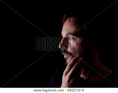 Low Key Image Of A Pondering Bearded Man