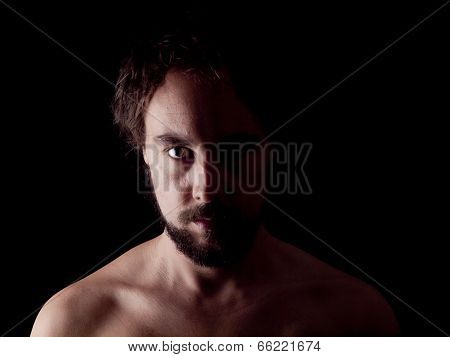 Low Key Image Of A Bearded Man